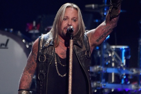 LAS VEGAS, NV - SEPTEMBER 19:  Singer Vince Neil of Motley Crue performs onstage during the 2014 iHeartRadio Music Festival at the MGM Grand Garden Arena on September 19, 2014 in Las Vegas, Nevada.  (Photo by Ethan Miller/Getty Images for iHeartMedia)
